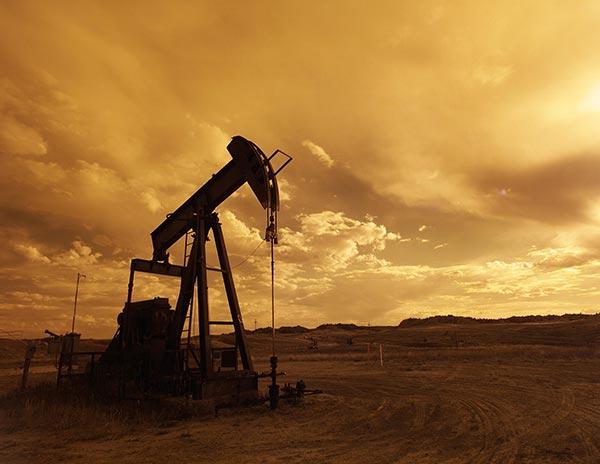oil-pump-jack-sunset-clouds-silhouette.jpg