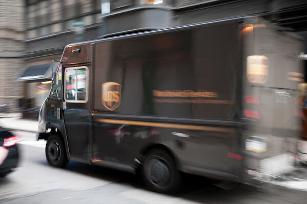 UPS truck in motion. UPS trucks use sensors to gather data to optimize routes.