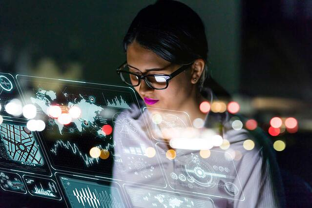 woman-engineer-looking-at-various-information-in-screen-of-futuristic-interface