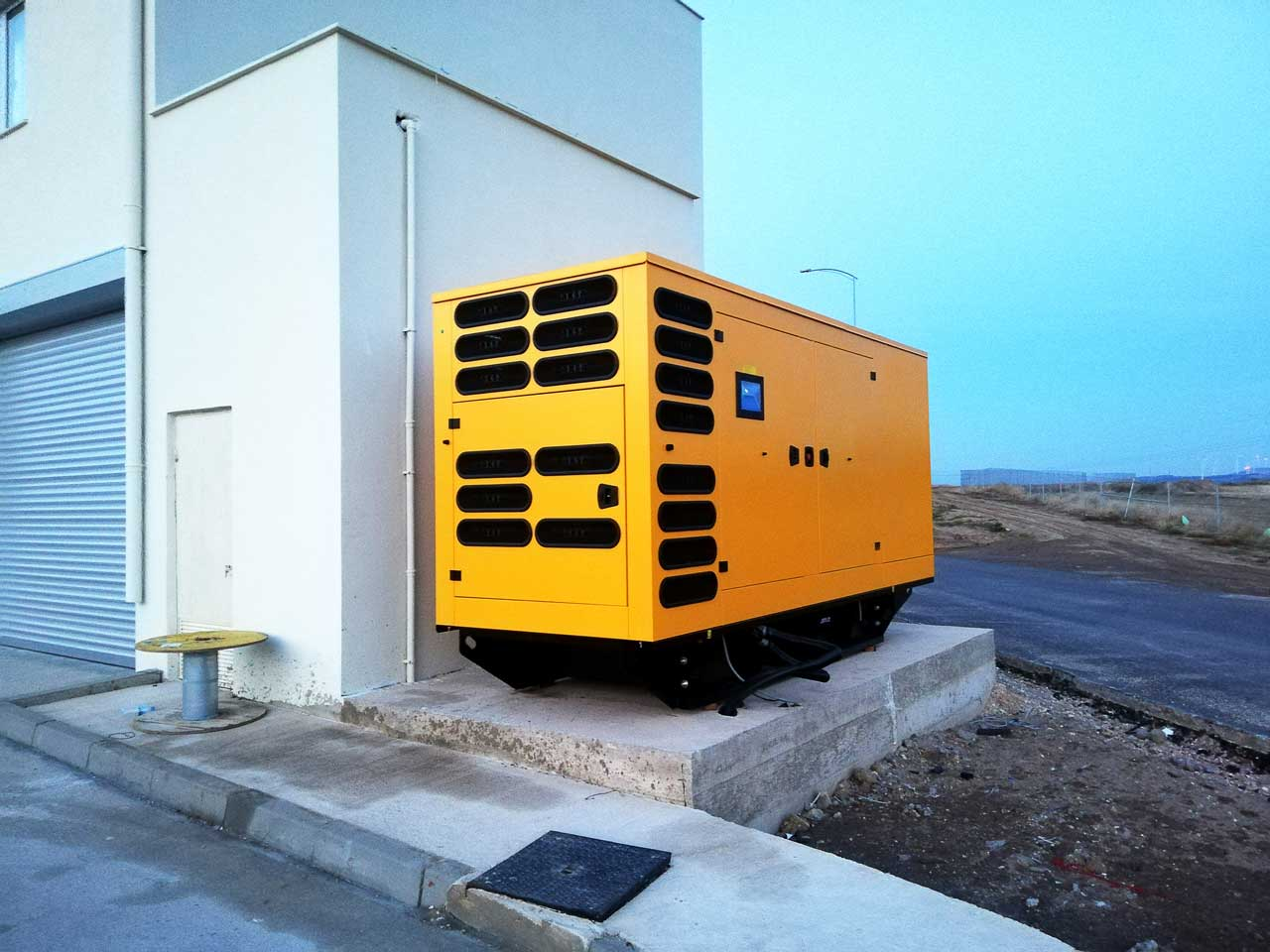 Diesel Electric Power Generator Near Building