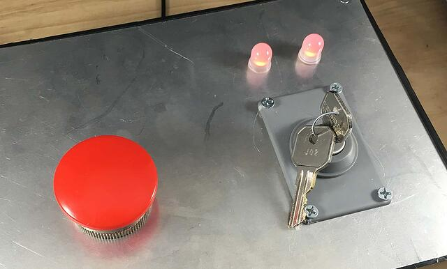 red LED light and keys to switch on device