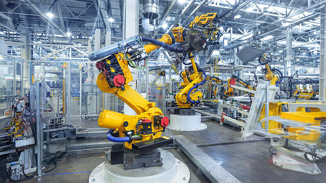 Robotic manufacturing machine in a plant environment.