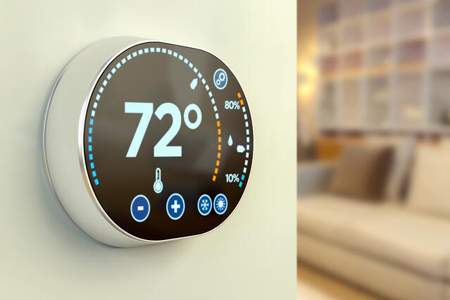 Close up of a smart thermostat on a wall