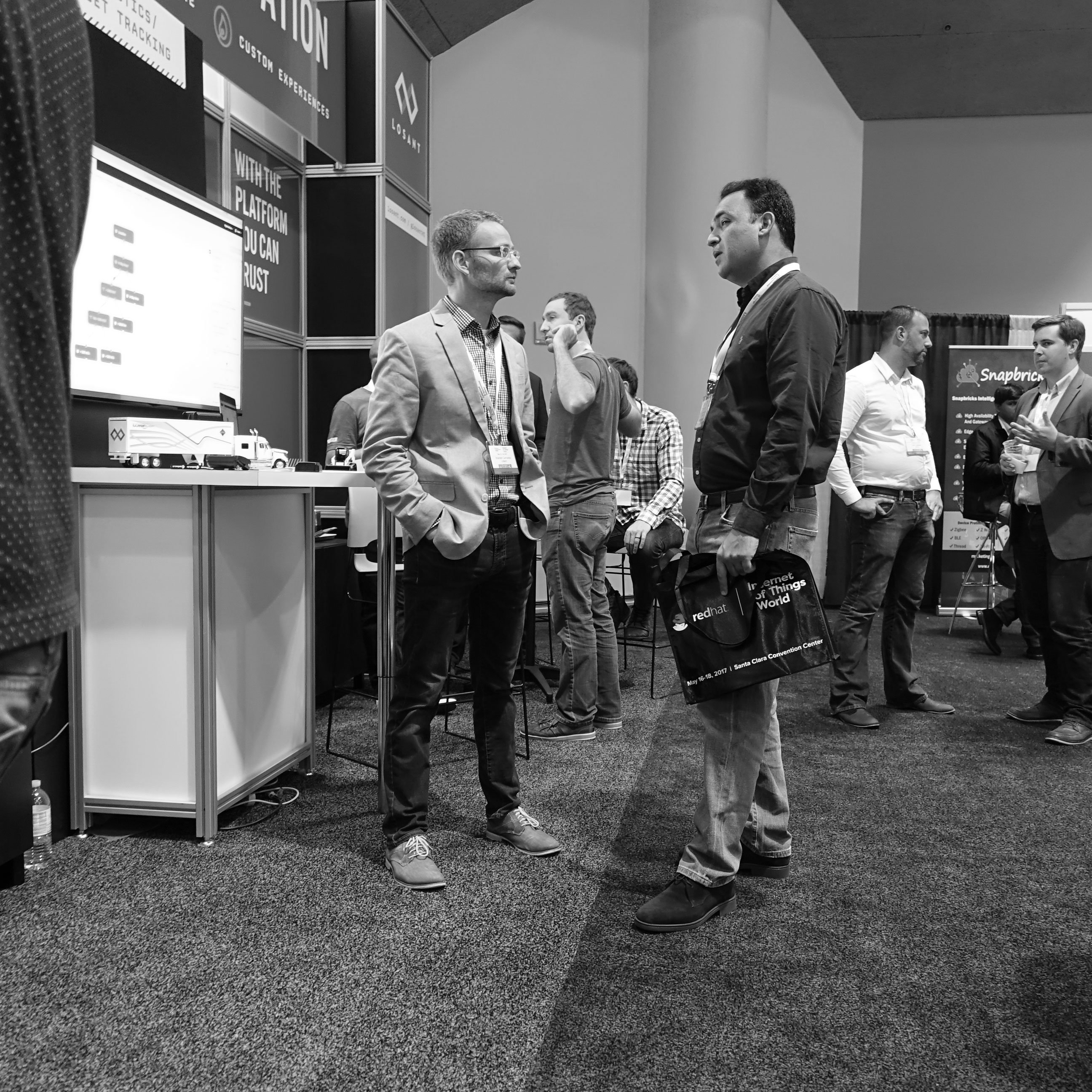 Brandon Cannaday meeting with potential client at Losant IoT World 2017 booth