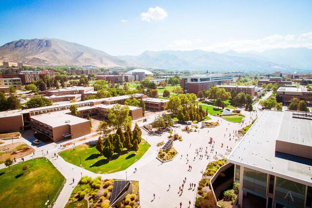Sunny Aerial view of Office Campus with Mountains in the background.