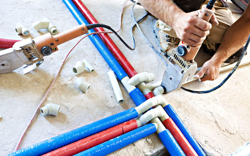 Red and Blue Plumbing Pipes