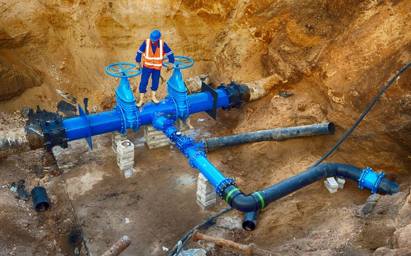 construction-underground-man-water-pipes