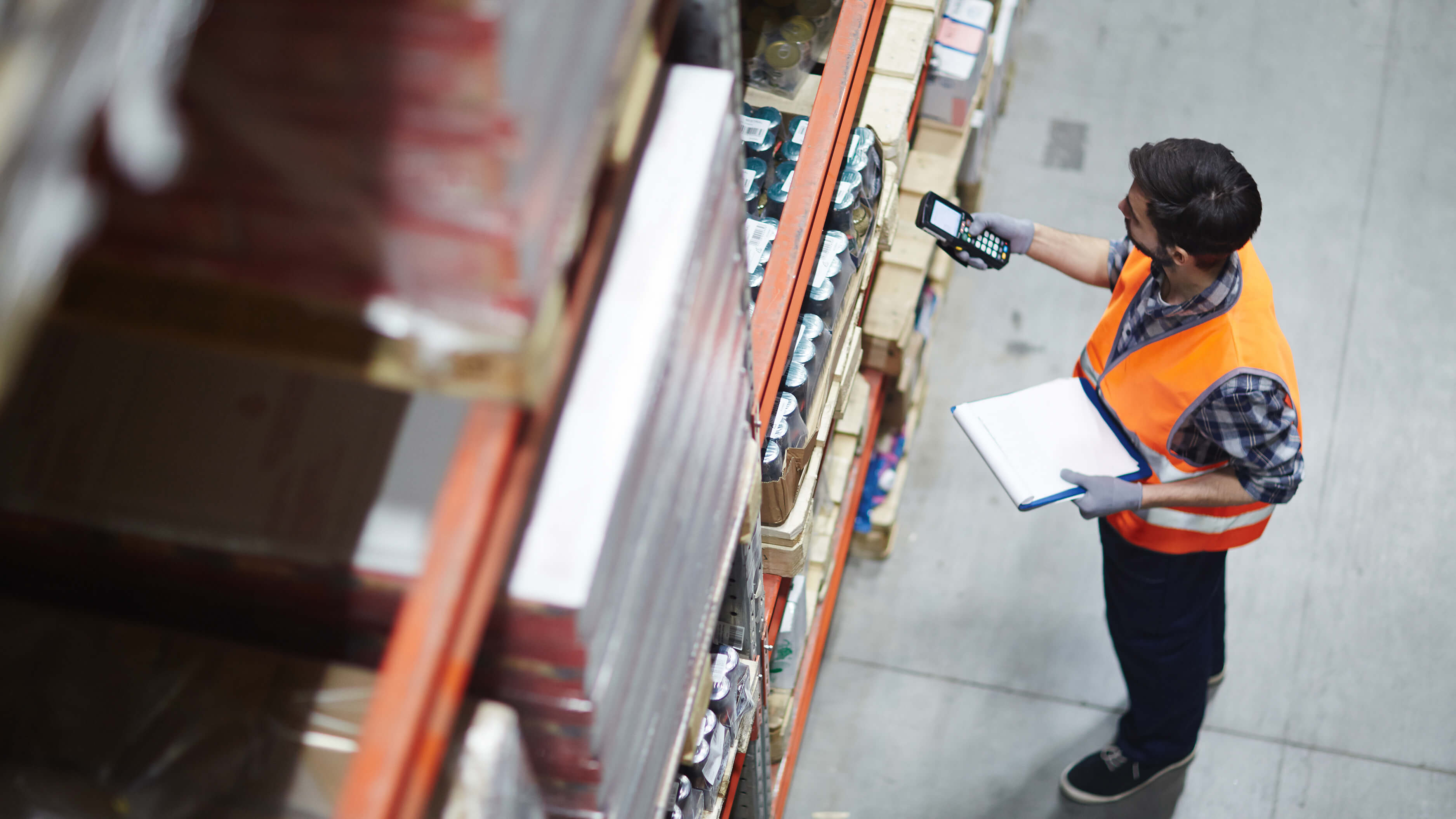 Man-scanning-boxes-in-warehouse