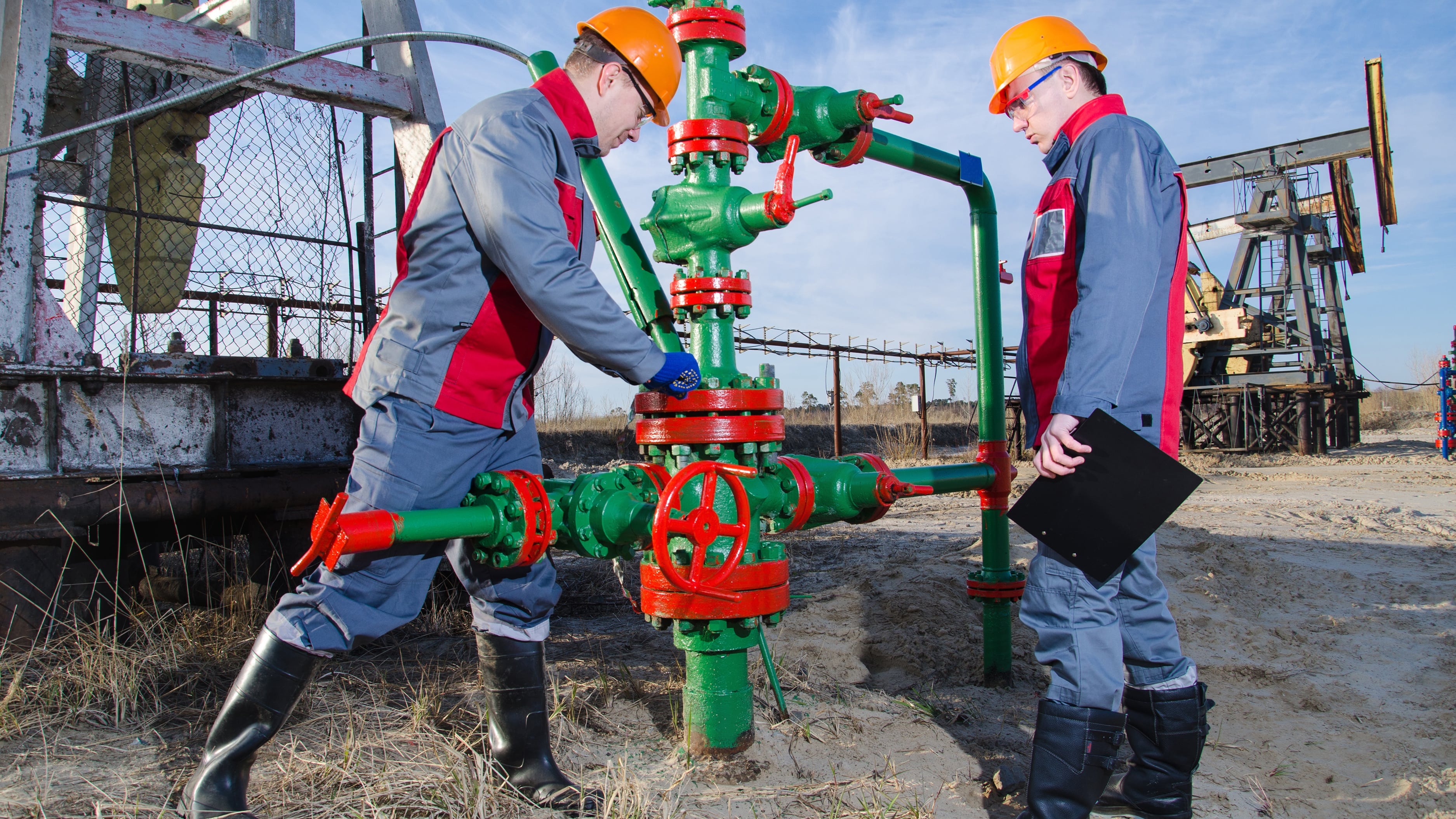 men-inspecting-pipes-on-job-site